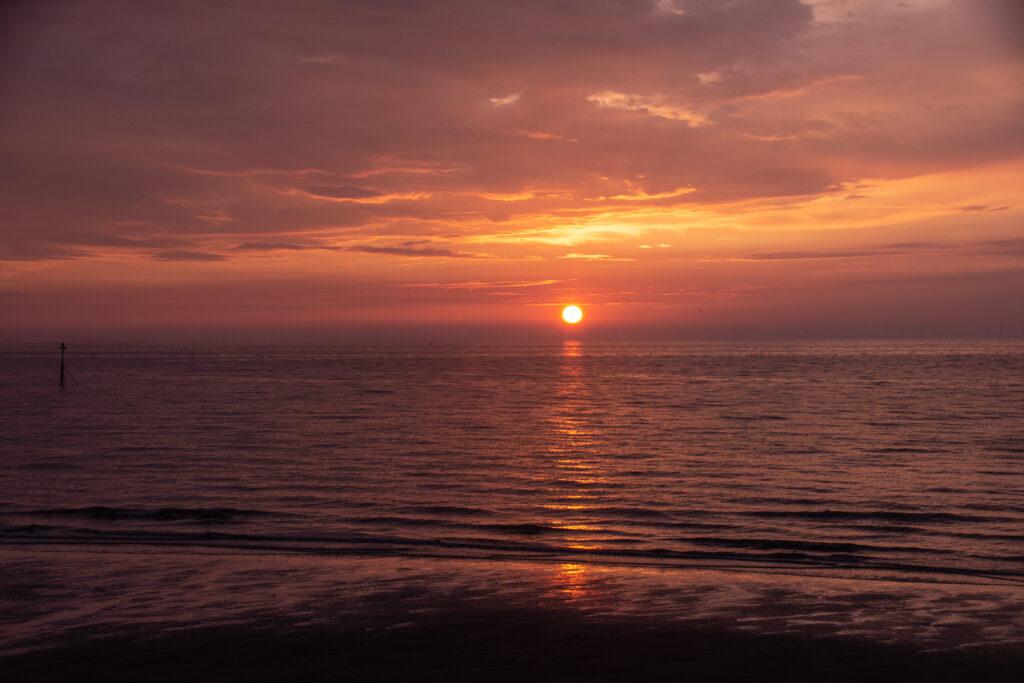 Margaret Salisbury - Sun setting over the sea